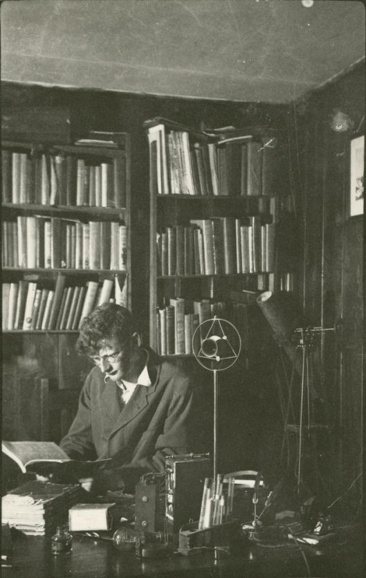 Arthur C. Clarke reads in his study, circa 1936.